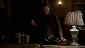 Alaric stands at Meredith's bag, emptying a syringe