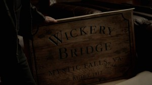 "Close up of the sign, which reads ""Wickery Bridge, Mystic Falls VA, Built 1912"""