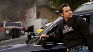 Raylan in a US Marshal bomb vest