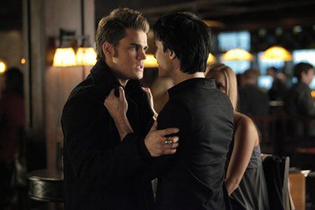 Stefan and Damon grab each other.