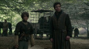Arya and Gendry stand beside each other looking apprehensive