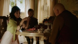 Shae smiles at Varys while Tyrion looks sceptical