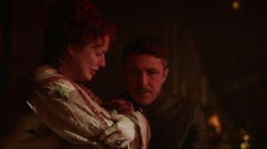 Ros cries while Littlefinger tries to comfort her