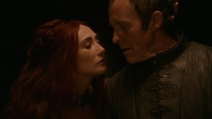 Melisandre leans in as if to kiss Stannis
