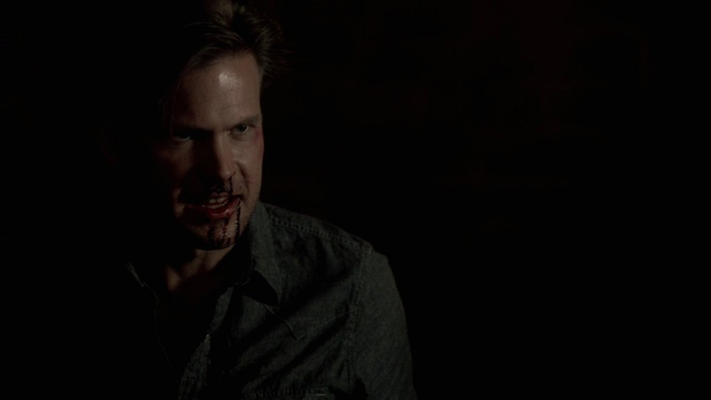 Close up of Evil Alaric with a bloody face
