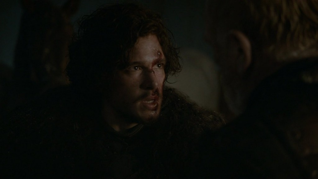 Jon, with a blood lip and nose, confronts Commander Mormont