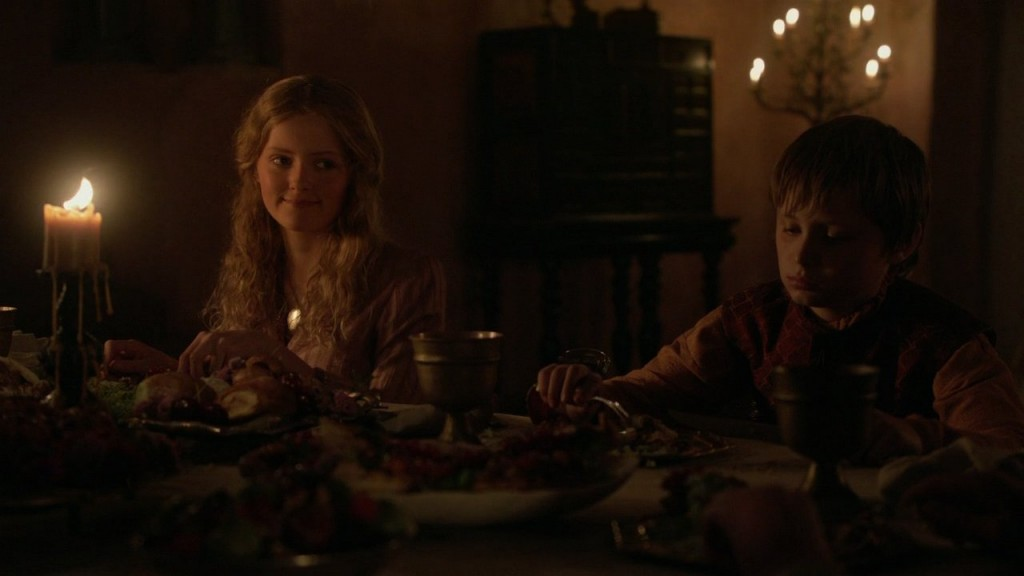 Myrcella smiles at Sansa; Tommen eats