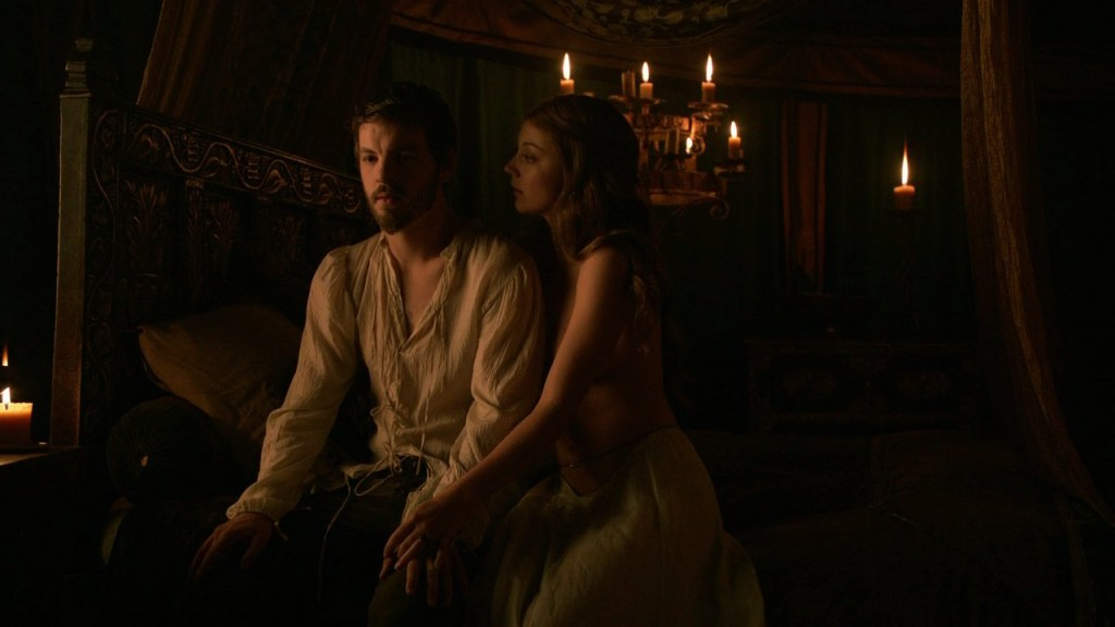 Renly and Margaery sit on his bed; she is holding his hand