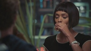 A screencap from the TV show Bones. The character Cam takes a shot of tequila