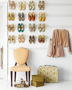 Shoes hung by heels on 4 strips of crown molding hung on a bedroom wall