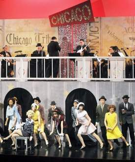 Cast performing Chicago