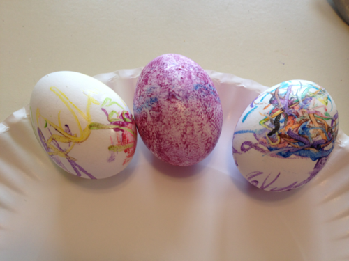 three eggs decorated with crayon