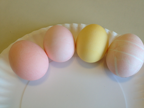 4 eggs dyed with Kool-Aid and soda