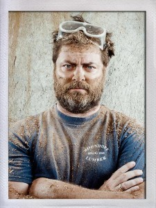 A picture of actor Nick Offerman with safety glasses on his head, covered in saw dust.
