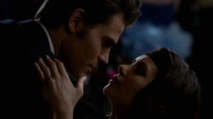 Close up on their faces as Stefan dips Elena while dancing