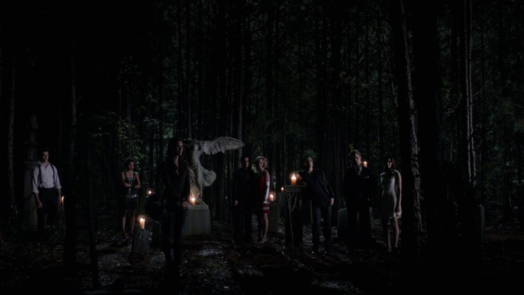 The gang stand outside the tomb, L-R: Jeremy, Bonnie, Meredith, Tyler, Caroline, Damon, Stefan, Elena.