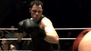 Helo in a boxing ring, looking angry