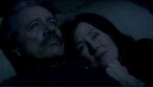 Adama and Roslin lie together, (dressed, in the dark, outside) with Roslin's head on Adama's shoulder.