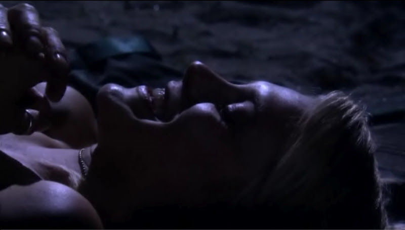 Starbuck's face in the dark, happy and giggling.