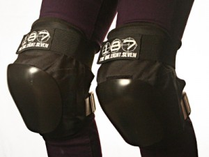Pair of legs with black and white kneepads