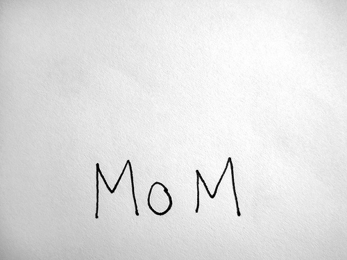 "white sheet of paper with the word ""MoM"" scrawled on it"