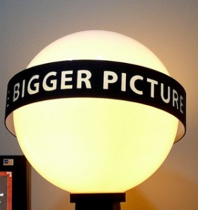 "A glowing sphere with a banner on it with the words ""The Bigger Picture"""