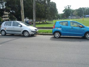 Two GoGet cars parked together.
