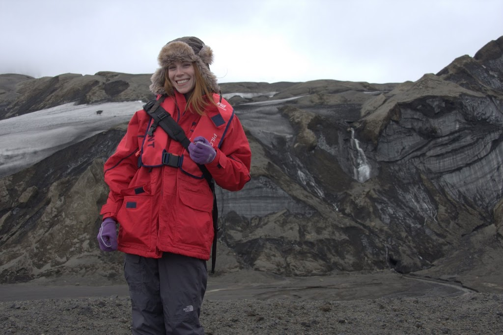 Kym in red jacket standing at an active volcano on Telefon Bay