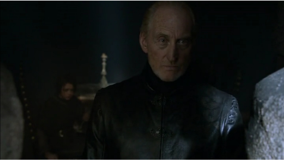 Close-up of Tywin, with Arya seated in the background