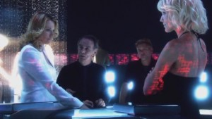 D'Anna, Cavil, Leoben and Caprica stand in their baseship, debating.