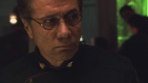 Adama, looking angry and resolute.
