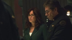 At the Bridge, Adama's head is down and he looks resolute, and Roslin looks worried.