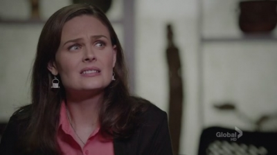 A screenshot from the show Bones: Brennan grimacing