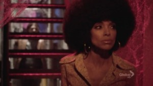 A screenshot from the show Bones: The actress that plays Cam also playing a 70's esque vampire with a huge afro