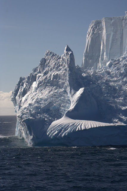 awesome iceberg with pointy peaks and cloudy shaped piles of ice