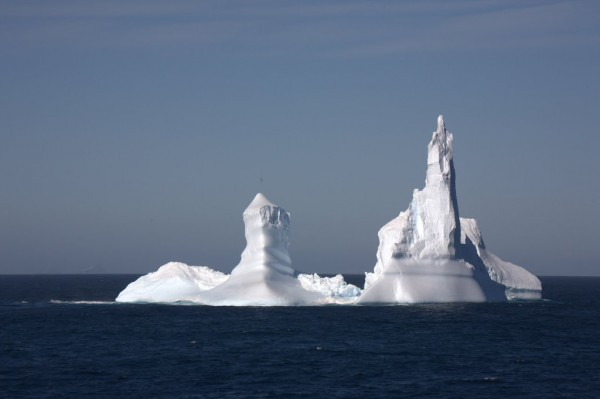Two pointed peaks on an iceberg that look like a stubby penis and a middle finger