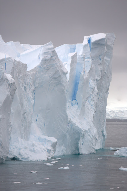 large iceberg with crack running down the center