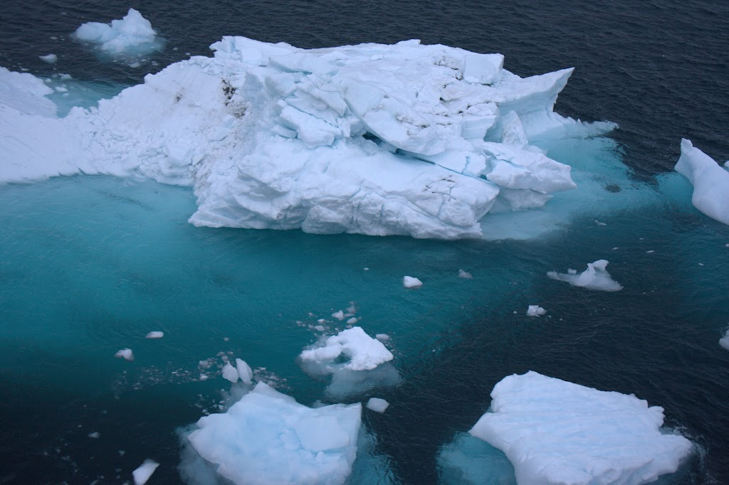 shot of icebergs from ship
