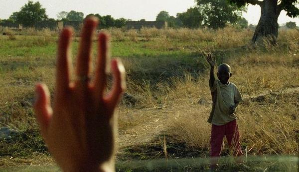 waving to a Chadian boy