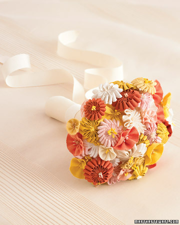 yellow, pink, orange and white bouquet made from ribbon on a cream background