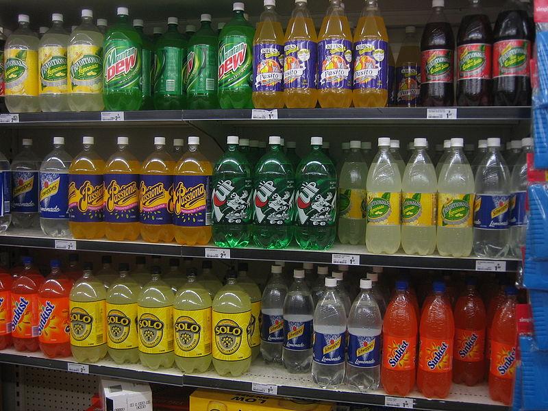 soda soft drink 2 liter bottles on shelf at supermarket