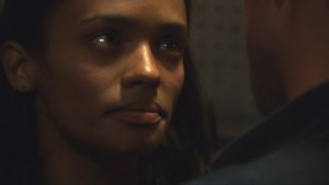 a closeup on Dee, who is looking at Lee, hurt and resolute.