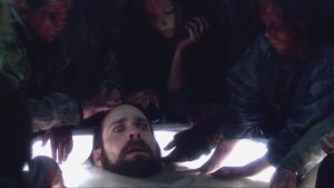 Baltar in the Cylon resurrection tub, surrounded by blood-covered children.