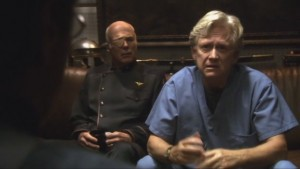 Doc Roberts and Tigh sit on a couch in Adama's quarters