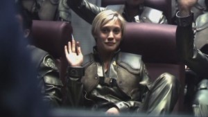 Starbuck, in her flight suit, waves at us.