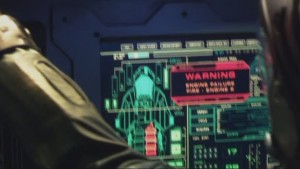 """A computer screen on a Raptor, saying """"Fire in Engine B"""""""
