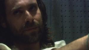 A closeup of Baltar's face. He looks condescending.
