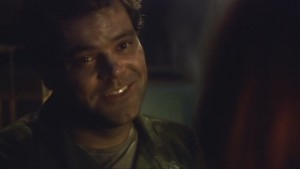 Tyrol, dirt-stained, smiles as he talks to Roslin.