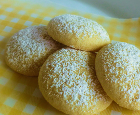 pic of lemon drop cookies on white and yellow cloth