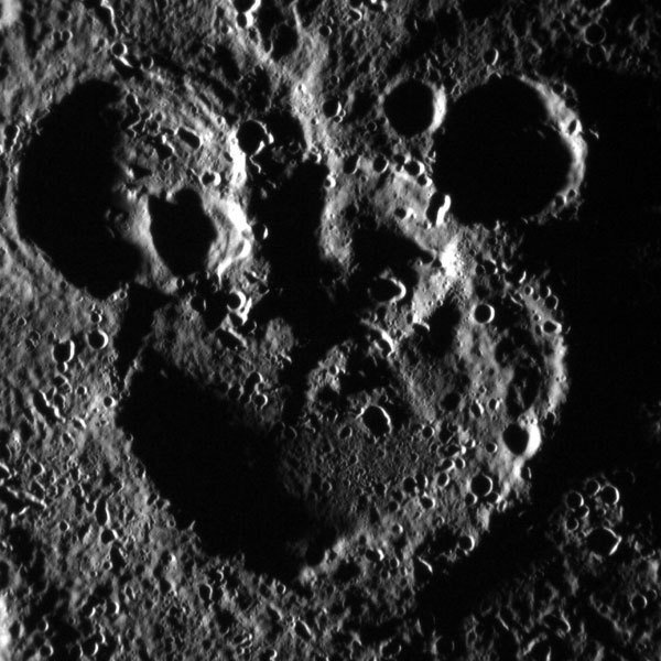 Overlapping craters on the surface of Mercury that resemble Mickey Mouse
